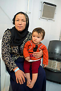 Greece  Chios Island, one of the places where refugees from Turkey land en route to Northern Europe. Souda camp. Baby Ashrafi with her mother waiting at the clinic.