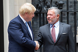 © Licensed to London News Pictures. 07/08/2019. London, UK. British Prime Minister Boris Johnson (L) shakes the hand of The King of Jordan Abdullah II bin Al-Hussein outside 10 Downing Street.  Photo credit: George Cracknell Wright/LNP