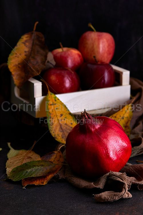Autumnal still life with pomegranate and apples