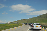 Excessive heavy traffic on a narrow road leading to place of Interest (Mount Hermon). Photographed on a Sunny winter day, Golan Heights, Israel