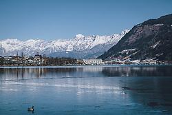 THEMENBILD - der Zeller See, die Stadt Zell am See, das Grandhotel und das verschneite Steinerne Meer, aufgenommen am 13. Februar 2021 in Zell am See, Oesterreich // the Zeller See, the town of Zell am See, the Grandhotel and the snow-covered Steinerne Meer, in Zell am See, Austria on 2021/02/13. EXPA Pictures © 2021, PhotoCredit: EXPA/Stefanie Oberhauser