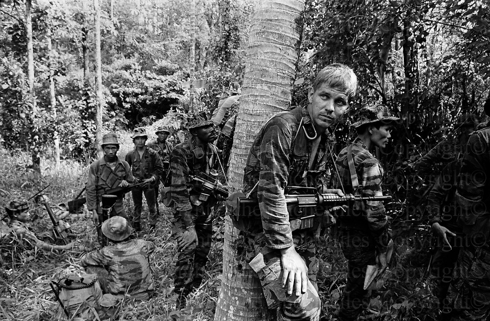 American Special Forces seen during a patrol in the Central Highlands with a unit of the South Vietnamese Army. October 1970. The Vietnam War was fought between 1st November 1955 until the fall of Saigon on 30 April 1975. Photographed by award winning photographer Terry Fincher. Contact thefincherfiles@btinternet.com for publication fees and permissions.