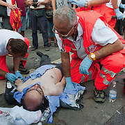 VENICE, ITALY - SEPTEMBER 17:  A member of the local assembly Beppe Caccia of the Green Party receives medical assistance from paramedics after being injured during clashes between police and demonstrators ahead of tomorrow's Northern League rally on September 17, 2011 in Venice, Italy. Clashes broke out between police and protesters after a coalition opposed to the Northern League demonstrated against the party's planned rally to be held at the Riva Sette Martiri in Venice.