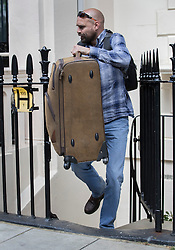 © Licensed to London News Pictures. 24/05/2016. London, UK. A member of Jose Mourinho's staff carries a suitcase from  his London home. Mourinho is expected to be named as Manchester United manager in the next few days. Photo credit: Peter Macdiarmid/LNP