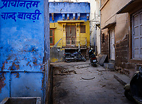 JODHPUR, INDIA - CIRCA NOVEMBER 2018: Typical street of Jodhpur. Jodhpur is the second largest city in the Indian state of Rajasthan. Jodhpur is a popular tourist destination, featuring many palaces, forts and temples, set in the stark landscape of the Thar Desert. It is popularly known as Blue city and Sun city among people of Rajasthan and all over India