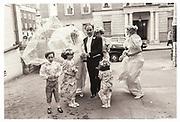 RUPERT MURDOCH ARRIVING WITH PRUDENCE MURDOCH, LADY EDWARD SOMERSET, HENRIETTA BOLLARD, LUCY MOOREHEAD, ELIZABETH MURDOCH, AND PAGE: TOM BROOKSBANK, Wedding of Pru Murdoch and Crispin Odey. CHESTER SQ and the Park Lane Hotel. . London. 24 May 1985.