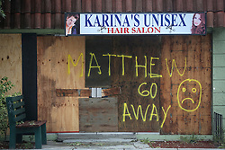 October 7, 2016 - Florida, U.S. - ''Matthew Go Away'' is spraypainted on the boards covering Karina's Unisex Hair Salon in Lake Worth Friday morning. (Credit Image: © Bruce R. Bennett/The Palm Beach Post via ZUMA Wire)