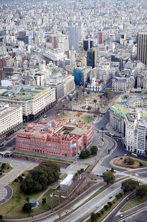 """Buenos Aires, Argentina 22 August 2009<br /> Aerial view of La Casa Rosada, officially known as the Casa de Gobierno or Palacio Presidencial, is the official seat of the executive branch of the Government of Argentina. <br /> The Casa Rosada sits at the eastern end of the Plaza de Mayo, a large square which since the 1580 foundation of Buenos Aires has been surrounded by many of the most important political institutions of the city and of Argentina.<br /> Its balcony, which faces the square, has served as a podium for most Argentine Presidents and a number of other historical figures, including Eva Perón, who rallied the """"descamisados """" from there, and Pope John Paul II, who visited Buenos Aires in 1982 and in 1987. Madonna, in 1995, sang her filmed rendition of the song """"Don't Cry for Me Argentina,"""" for the movie Evita.<br /> PHOTO: EZEQUIEL SCAGNETTI"""