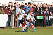 Nathan Thompson of Portsmouth collides with Rene Steer of Maidenhead United during the The FA Cup 1st round match between Maidenhead United and Portsmouth at York Road, Maidenhead, United Kingdom on 10 November 2018.