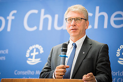 """18 September 2017, Geneva, Switzerland: The World Council of Churches formally opens the """"12 Faces of Hope"""" exhibition at the Ecumenical Centre in Geneva. The exhibition faces 12 people from Israel and Palestine, sharing testimonies of hope, towards a future of justice and peace in the Holy Land. Here, World Council of Churches general secretary Rev. Dr Olav Fykse Tveit."""