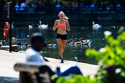 A woman runs along The Serpentine in Hyde Park as another heatwave day begins with temperatures expected to soar. London, July 01 2018.
