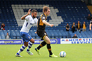 Newport County's Adam Chapman (r) gets past the challenge of Bury's Tom Soares. Skybet Football League two match, Bury v Newport county at Gigg Lane in Bury on Saturday 5th Oct 2013. pic by David Richards, Andrew Orchard sports photography,