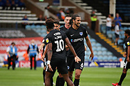 Portsmouth defender Christian Burgess (6) celebrates after the EFL Sky Bet League 1 match between Peterborough United and Portsmouth at London Road, Peterborough, England on 15 September 2018.