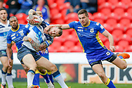 Featherstone Rovers winger Luke Briscoe (5)  gets a high tackle from Doncaster RLFC full back Jack Sanderson (24)  during the Challenge Cup 2018 match between Doncaster and Featherstone Rovers at the Keepmoat Stadium, Doncaster, England on 22 April 2018. Picture by Simon Davies.