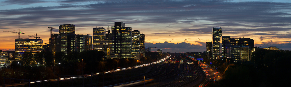 Panoramic view of Zuidas at dusk the business and commercial centre of Amsterdam.