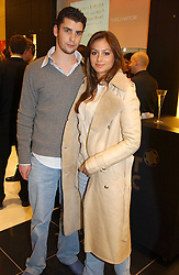 """SASKIA BOXFORD and THEO OSBORNE at a party to celebrate the opening of the new Mont Blanc store at 151 Sloane Street, London on 9th March 2005.  The evening was held in conjunction with UNICEF's """"Sign up for the right to write"""" campaign which is raising money though the sale of celebraties 'statements' currently for auction on the ebay website.<br /><br />NON EXCLUSIVE - WORLD RIGHTS"""