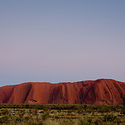 Uluru in the morning, at sunrise. Uluru (Ayers Rock or Red Rock) in Northern Territory. World Heritage Site, Uluru-Kata Tjuta National Parl is sacred to the Anangu, the Arboriginal People of the area.