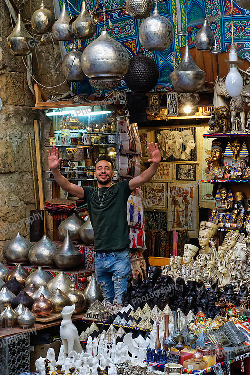 Enthusiastic salesman trying to attract potential customers to visit his shop in the Khan El Khalili Market in Islamic Cairo