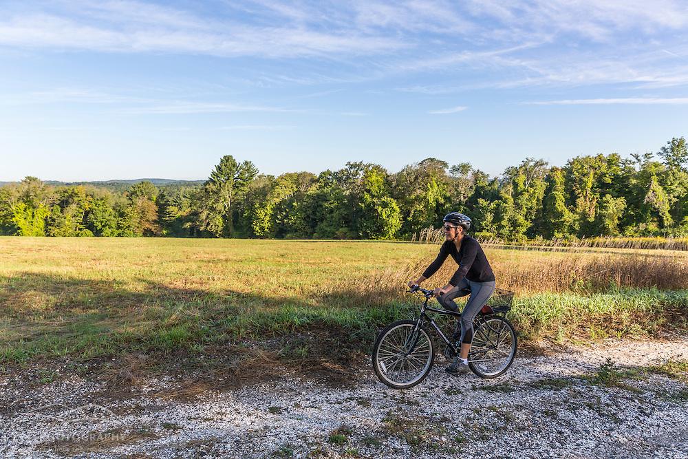 A woman rides her mountain bike on Sagamore Hill in Hamilton, Massachusetts.