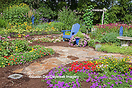 63821-21819 Flower garden with blue Adirondack chair, bird bath, butterfly house and blue bird house. Butterfly Bushes, Peach & Purple Verbenas, Yellow Lantana (Lantana camara), Karl Forster Grass, Black-eyed Susans (Rudbeckia hirta), Homestead Purple Verbena canadensis), Red Verbena, New Gold Lantana (Lantana camara)  Marion Co., IL