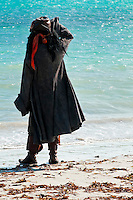 Pirate man, looking at the ocean from the beach.