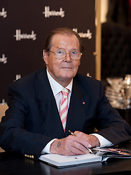 © Licensed to London News Pictures. 11/10/2012. London, U.K..Actor Roger Moore signing his new book 'Bond On Bond' At Harrods Store in knightsbridge, London, today (11/10/2012). The James Bond legend appears in store to sign copies of his new book, Bond on Bond (published October 4)..Photo credit : Rich Bowen/LNP
