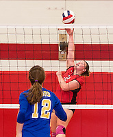 Laconia's MJ Bordeau goes up for a spike during NHIAA DIvision II Volleyball with Gilford on Wednesday evening.  (Karen Bobotas/for the Laconia Daily Sun)