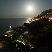 Moon shines over the city of Ravello, on the Amalfi coast, Italy