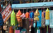 Love Shack Bar 'n' Restaurant, shawls, and decorative lampshades, at Lakeside, in Pokhara, Nepal.