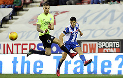 Marcus Maddison of Peterborough United closes down Reece James of Wigan Athletic - Mandatory by-line: Joe Dent/JMP - 13/01/2018 - FOOTBALL - DW Stadium - Wigan, England - Wigan Athletic v Peterborough United - Sky Bet League One