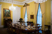 Nottoway plantation 19th Century antebellum mansion dining room with table settings and chandelier in Louisiana, USA