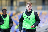 AFC Wimbledon defender Jack Currie (26) and AFC Wimbledon attacker Zach Robinson (14) warming up as sub during the EFL Sky Bet League 1 match between AFC Wimbledon and Lincoln City at Plough Lane, London, United Kingdom on 2 January 2021.