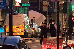 """Finsbury Park, London, June 19th 2017. A major police and emergency services operation with firearms officers in attendance is underway near Finsbury Park Mosque following reports of Several people being injured after a van struck a crowd of pedestrians near a north London mosque in what police have called a """"major incident"""". A police tent is in place at the scene."""