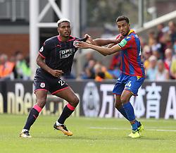 12 August 2017 London : Premier League Football : Crystal Palace v Huddersfield Town:  Palace defender Timothy Fosu-Mensa struggles to hold Steve Mounie (left): Photo: Mark Leech