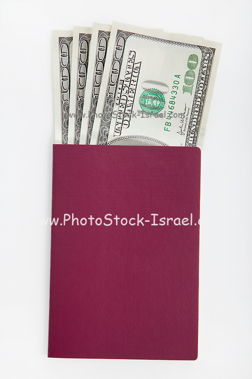 Cutout of a passport with US dollars on white background