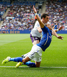 Anthony Knockaert of Leicester City is brought down by Leighton Baines of Everton - Photo mandatory by-line: Rogan Thomson/JMP - Mobile: 07966 386802 16/08/2014 - SPORT - FOOTBALL - Leicester - King Power Stadium - Leicester City v Everton - Barclays Premier League