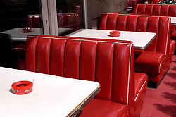 Detail of red bench seats in outdoor cafe in Mitte Berlin Germany