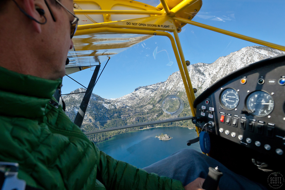 """""""Pilot over Emerald Bay 1"""" - This pilot was photographed flying an amphibious seaplane over Emerald Bay in Lake Tahoe, CA."""