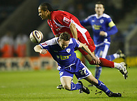 Photo: Steve Bond/Richard Lane Photography. Leicester City v Leyton Orient. Coca Cola League One. 10/01/2009. Paul Dickov (front) is brought down by Tamika Mkandawire (back)