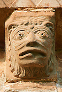 Norman Romanesque exterior corbel no 38 - sculpture of a head, half man half lion with a mouth like a theatrical mask. The Norman Romanesque Church of St Mary and St David, Kilpeck Herefordshire, England. Built around 1140 .<br /> <br /> Visit our MEDIEVAL PHOTO COLLECTIONS for more   photos  to download or buy as prints https://funkystock.photoshelter.com/gallery-collection/Medieval-Middle-Ages-Historic-Places-Arcaeological-Sites-Pictures-Images-of/C0000B5ZA54_WD0s