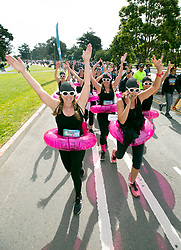 """A group of """"synchronized swimmers"""" paddle through Golden Gate Park at the 107th running of the Bay to Breakers, Sunday, May 20, 2018, in San Francisco. (Photo by D. Ross Cameron)"""