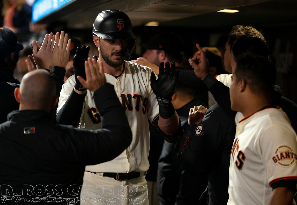 Sep 29, 2021; San Francisco, California, USA; San Francisco Giants left fielder Kris Bryant (23) is congratulated by his teammates after driving in the go-ahead run against the Arizona Diamondbacks on a sacrifice fly during the seventh inning at Oracle Park. Mandatory Credit: D. Ross Cameron-USA TODAY Sports