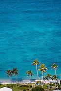 Palm trees line the shore of Lanikai beach, Oahu, Hawaii