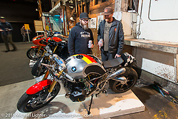 Checking out Jeff Wright's custom RnineT BMW at the displays on Friday night at the One Show motorcycle show in Portland, OR. February 12, 2016. ©2016 Michael Lichter