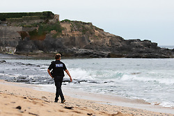 © Licensed to London News Pictures. 21/05/2020. Padstow, UK. A police officer walks along Constantine Bay beach in Cornwall during a spell of hot weather. Photo credit : Tom Nicholson/LNP