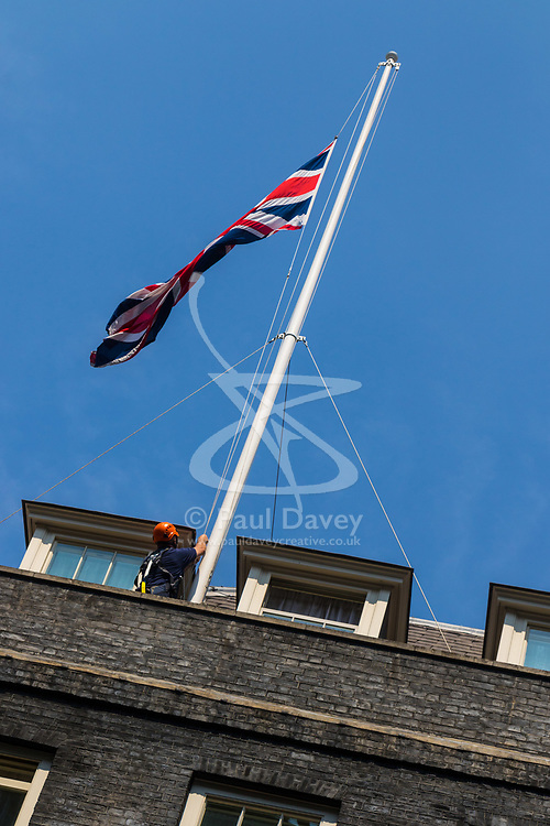 London, June 19th 2017. Workers lower the flags at Downing Street to half mast in the wake of the Finsbury Park attack which left one dead and ten injured after a van was driven into Muslim worshipers.
