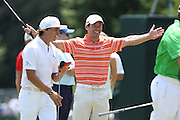 June 12 2013: Rickie Fowler and Paul Casey joke around on the practice green during the wednesday practice round at the 2013 U.S. Open hosted by Merion Golf Club in Ardmore, PA.