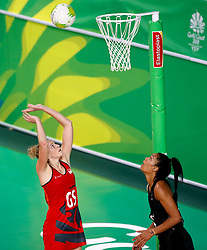 England's Joanne Harten (GS) shoots against New Zealand in the netball at the Gold Coast Convention and Exhibition Centre during day seven of the 2018 Commonwealth Games in the Gold Coast, Australia.