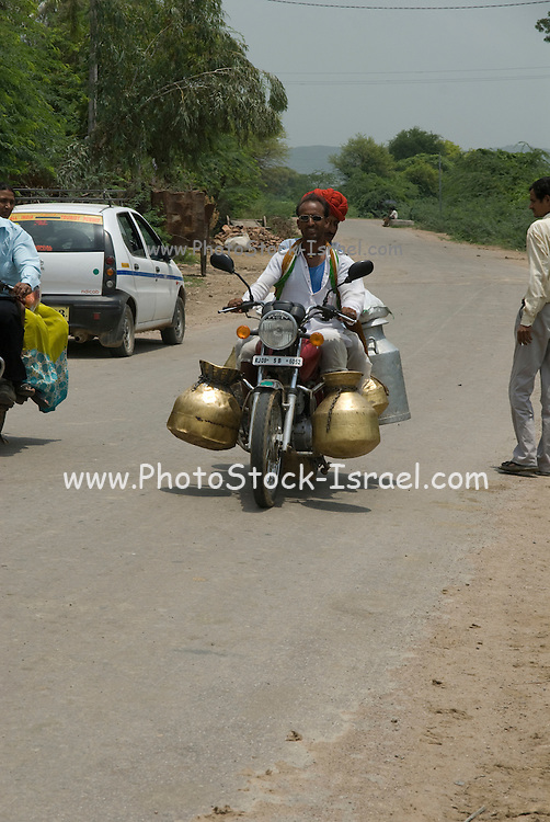India, Rajasthan milk delivery on a motorbike