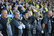Nigel Clough and his staff one minute silence during the EFL Sky Bet Championship match between Burton Albion and Leeds United at the Pirelli Stadium, Burton upon Trent, England on 22 April 2017. Photo by John Potts.